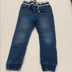 Lightly worn. Blue jean (soft material).